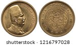 Egypt Egyptian golden coin 100 one hundred piastres 1922, head of King Fuad I in fez right, denomination above center circle with signs in Arabic, dates and three stars below,