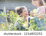 mother with her young daughter... | Shutterstock . vector #1216852252