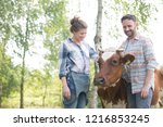 female and male farmers... | Shutterstock . vector #1216853245