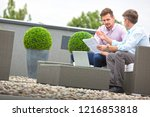 two attractive business man... | Shutterstock . vector #1216853818