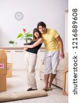 young pair moving to new flat... | Shutterstock . vector #1216889608