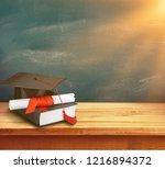 graduation mortarboard on book...   Shutterstock . vector #1216894372
