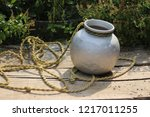 Small photo of water carrier aluminium pots with rope