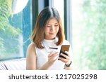 young beautiful asian woman... | Shutterstock . vector #1217025298