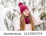 smiling young woman outdoors in ... | Shutterstock . vector #1217057575