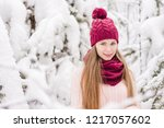 smiling young woman outdoors in ... | Shutterstock . vector #1217057602