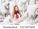 smiling young woman outdoors in ... | Shutterstock . vector #1217057605