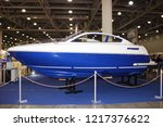 Small photo of Moscow / Russia – 03 08 2018: Fiberglass motor boat Sirius with transverse redan at the Yacht exhibition Moscow Boat show MBS 2018 in Crocus Expo