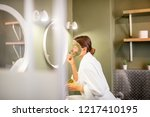 young woman in bathrobe... | Shutterstock . vector #1217410195