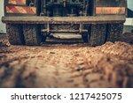Dump Truck Ground Works Closeup Photo. Heavy Duty Vehicle Rear Wheels Closeup. Construction Site. - stock photo