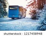 Bus On Winter Road Through...