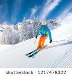 skier skiing downhill during... | Shutterstock . vector #1217478322