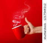 cup of fragrant coffee in hand... | Shutterstock . vector #1217549212