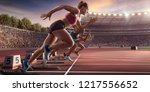 female athletes sprinting.... | Shutterstock . vector #1217556652