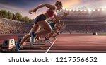 female athletes sprinting.... | Shutterstock . vector #1217556652