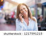 beautiful middle age hispanic... | Shutterstock . vector #1217591215