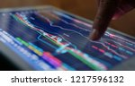 stock market data on tablet... | Shutterstock . vector #1217596132