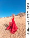 girl posing in a red skirt in... | Shutterstock . vector #1217611858