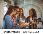 young freelance team at a... | Shutterstock . vector #1217612665