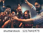 cropped shot of a group of... | Shutterstock . vector #1217641975