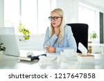 young woman sitting at the desk ... | Shutterstock . vector #1217647858