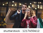 beautiful couple with shopping...   Shutterstock . vector #1217650612