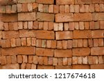 stacked red bricks with rough... | Shutterstock . vector #1217674618