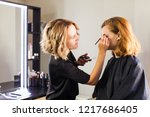 stylist makes young girl... | Shutterstock . vector #1217686405