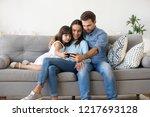 multi ethnic family sitting on... | Shutterstock . vector #1217693128
