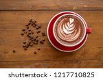 red coffee cup put on an old...   Shutterstock . vector #1217710825