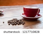 red coffee cup put on an old...   Shutterstock . vector #1217710828