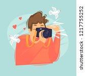 man makes a photo. photographer.... | Shutterstock .eps vector #1217755252