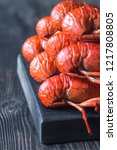 boiled crayfish on the wooden... | Shutterstock . vector #1217808805
