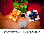 gifts  coffee and feet on the... | Shutterstock . vector #1217858875