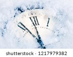 christmas time clock under snow | Shutterstock . vector #1217979382