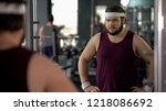 unhappy overweight man looking... | Shutterstock . vector #1218086692