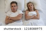 upset young couple lying in bed ... | Shutterstock . vector #1218088975