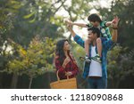 happy young couple standing in... | Shutterstock . vector #1218090868