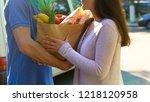 smiling woman receiving grocery ... | Shutterstock . vector #1218120958