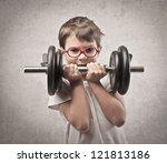 child raising a dumbbell | Shutterstock . vector #121813186