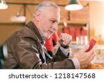 man with phone. bearded grey... | Shutterstock . vector #1218147568