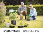 happy senior couple gardening... | Shutterstock . vector #1218168142