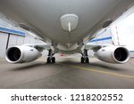 civil white airplane view on a... | Shutterstock . vector #1218202552