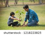 happy father and son planting a ...   Shutterstock . vector #1218223825