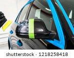 car polish wax worker hands... | Shutterstock . vector #1218258418