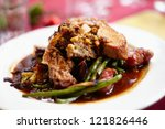 Sliced turkey with apple sausages, vegetables and sauce - stock photo
