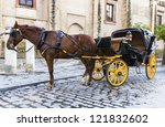 horse carriage in front of... | Shutterstock . vector #121832602