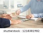 man exchanging money at cash... | Shutterstock . vector #1218381982
