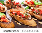 bruschetta  on slices of... | Shutterstock . vector #1218411718