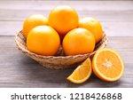 ripe orange fruit in basket on... | Shutterstock . vector #1218426868
